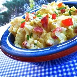 Creamy Carolina Potato Salad Recipe - Potatoes and hard-boiled eggs are coated in a creamy bacon dressing perfectly seasoned to create a potato salad that will soon become a family favorite.
