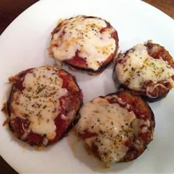 Eggplant Pizzas Recipe - A lightly fried slice of eggplant replaces the dough in this versatile pizza.