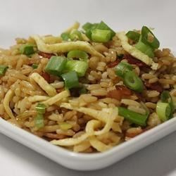 Classic Fried Rice Recipe - Here's the perfect way to use leftover rice--fried rice with bacon makes a quick weeknight meal, and it's ready in just minutes.