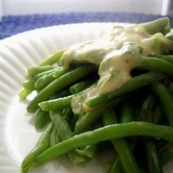 Mustard Green Beans Recipe - Fresh green beans are covered with a tangy honey mustard sauce. This easy dish is perfect for a cookout!