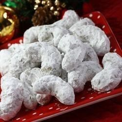 Pecan Crescents Recipe - Pecan wedding cookies rolled in confectioner's sugar.
