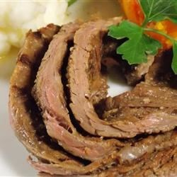 Tender Flank Steak Recipe - Marinate your flank steak in a mixture of garlic, soy sauce, and Worcestershire sauce for a tender and flavorful result.