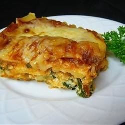 Easy Vegetarian Spinach Lasagna Recipe - An easy vegetarian lasagna is filled with spinach and ricotta cheese and has a topping of mozzarella and Parmesan.