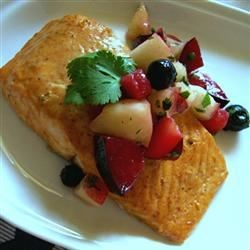 Curried Salmon with Summer Fruit Chutney Recipe - Salmon is marinated in lime juice and curry paste before being baked.  The spicy curry is offset with a homemade fruit chutney for a refreshing summertime seafood dish.