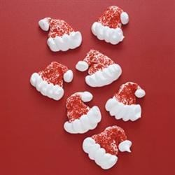 Santa Hats Recipe - Adorable little meringue Santa hat cookies are colored red with white pom-poms and trim. They're gluten-free so everybody can enjoy them.