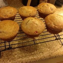 Lemon Cranberry Whole Wheat Muffins Recipe - These zingy whole wheat muffins, with flax seed and a touch of applesauce, make a tasty breakfast or snack for days when you're on-the-go.