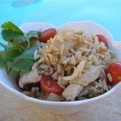 Thai Pork Fried Rice Recipe - Use boneless pork chops and cooked rice to make a spicy, flavorful Thai-style fried rice dish with tomatoes, bean sprouts, and grape tomatoes.