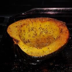 Garlic Butter Acorn Squash Recipe - Baked acorn squash topped with butter and garlic is a quick and easy side dish for the autumn dinner table.