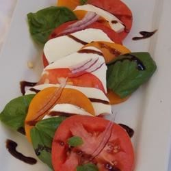 Tami's Tri Color Caprese Salad Recipe - A bright and colorful caprese salad with red and yellow tomatoes and green basil leaves is fresh-tasting and easy to make.