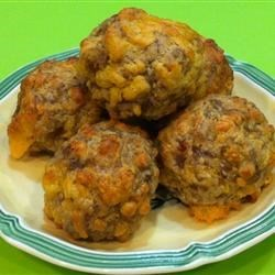 Sausage Balls Recipe - These baked meat balls are made with pork sausage, buttermilk biscuit mix and a can of condensed cheddar cheese soup.  Serve as an appetizer skewered with toothpicks.