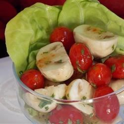 Tomato and Mushroom Salad Recipe - Mushrooms and cherry tomatoes marinate in your favorite Italian dressing in this fabulous but easy salad.