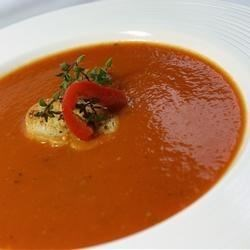 Roasted Red Pepper and Tomato Soup Recipe - Roasted peppers, tomatoes, sauteed aromatics and seasonings are cooked in chicken broth,  strained, pureed, and thickened with a roux to create this creamy soup.
