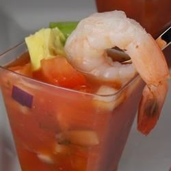 Cool Mexican Shrimp Cocktail Recipe - Shrimp, vegetable juice cocktail, and plenty of fresh and spicy Mexican ingredients make up a delicious, light appetizer served chilled in martini glasses.