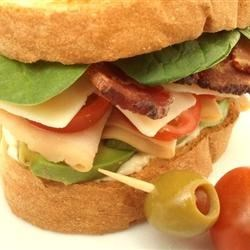Turkey Bacon Avocado Sandwich Recipe - Thinly sliced deli turkey, bacon, avocado and garden-ripe tomatoes make a perfect summertime sandwich.
