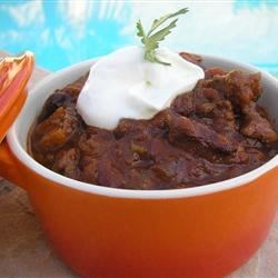 Killer Chili Recipe - Invite the gang over! You'll need them to help eat this huge pot of zesty chili with tender beef and smoky bacon in every bite. Adjust the heat to your liking by adding more or less crushed red pepper flakes and use your favorite combination of beans.