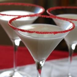 Peppermint Martini Recipe - Peppermint schnapps, white creme de menthe, and vanilla vodka are shaken together and served in a martini glass for a strong Christmas cocktail perfect for holiday parties.