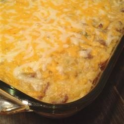 Cheese Mexican Corn Spoon Bread Recipe - Cream-style corn, whole corn kernels, sour cream, butter, green chilies, ground meat and sharp cheddar cheese are combined with a packaged corn bread mix in this moist, pudding-like main dish.