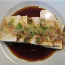 Tofu Hiyayakko Recipe - This traditional Japanese dish is simply a few slices of soft tofu topped with fresh ginger and green onion with a wonderfully light dressing.