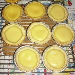"Egg Tarts II Recipe - ""Yummy Asian egg tarts! This recipe makes 22 3-inch tarts. First, mix up a batch of shortdough pastry, then fill them  with egg custard and bake."""