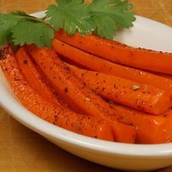 Spicy Glazed Carrots Recipe - Carrots cooked with brown sugar, cinnamon, cayenne pepper, and a hint of nutmeg make a flavorful and easy side dish that's great with fall meals.