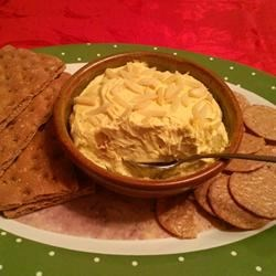 Curry Cheese Ball Recipe - This is a very easy and deliciously different cheese ball; your guests will love it! The curry and cream cheese are rich and tasty. This is best served on a hearty wheat cracker.