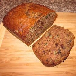 Abby's Super Zucchini Loaf Recipe - This spiced zucchini-walnut bread is especially light in texture, owing to the easy process of extracting the extra liquid from the zucchini before mixing it in.  This recipe yields two loaves, and they will be gone before you know it.