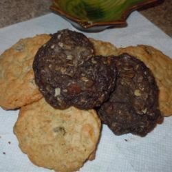 Coconut Buffalo Chip Cookies Recipe - Standard chocolate chip cookie dough is loaded up with coconut, corn flakes, and raisins creating a buffalo chip cookie, also known as 'everything but the kitchen sink' cookie.