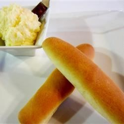 Breadsticks with Parmesan Butter Recipe - Freshly baked breadsticks are served alongside Parmesan butter for a garlicky accompaniment to your meal.