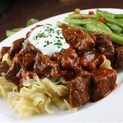 Hungarian Goulash I Recipe - Beef chuck is slowly stewed with onion, garlic, tomato paste and sweet Hungarian paprika for a tender, mildly spicy comforting dish.