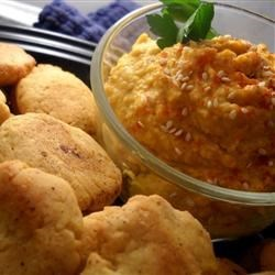 Savory Pumpkin Hummus Recipe - Traditional hummus gets a colorful twist with the addition of pumpkin puree. Serve with your favorite vegetables and pita bread!