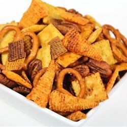 Reindeer Snack Mix Recipe - Savory, salty, crunchy, and sweet! All the flavors and textures you crave are in this interesting snack mix made from cereal, crackers, pretzels, and nuts, baked with a buttery, slightly spicy seasoning.