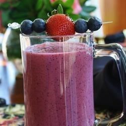 Simple Summer Smoothie Recipe - Banana, strawberries, blueberries, and cherries with a touch of honey are my favorite ingredients for this smoothie.