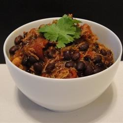 Grandma's Chicken and Black Bean Chili Recipe - This chili recipe is made quickly thanks to the use of canned chicken, diced tomatoes, and black beans.