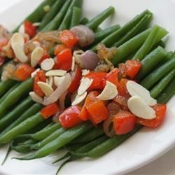 Green Beans with Almonds and Caramelized Shallots Recipe - Green beans are quickly steamed to tenderness, then mixed with sweet caramelized shallots, red bell pepper, and toasted almonds.