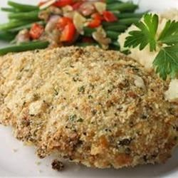 Tender Italian Baked Chicken Recipe - This baked chicken recipe is ready in just 30 minutes. An easy breadcrumb and Parmesan coating keeps each chicken breast moist and delicious.