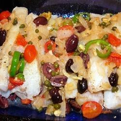 Veracruz-Style Red Snapper Recipe - Red snapper is cooked with a Mexican-inspired mixture of tomatoes, jalapeno peppers, olives, and oregano, for a light but flavorful meal.