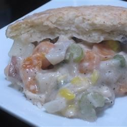 Easy Leftover Thanksgiving Turkey Pot Pie Recipe - Tasty, fast, and easy describe this pot pie made with cooked turkey meat, canned corn, carrots, and potatoes, and an easy topping made of baking mix.