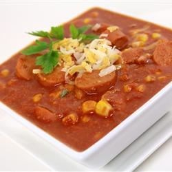 Hearty Hot Dog Soup Recipe - Sliced frankfurters are cooked with canned corn and American cheese  and spiced with chili powder and cayenne in this fast and easy soup.