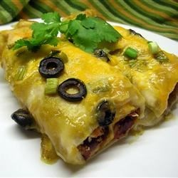 Sweet Potato Enchiladas Recipe - Corn tortillas are stuffed with a sweet potato and cream cheese filling and baked with enchilada sauce and cheese.