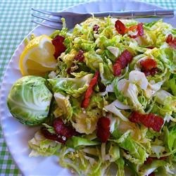 Brussels Sprouts with Bacon Dressing Recipe - This creative raw Brussels sprouts salad has a great contrast between the raw, crunchy vegetable and the rich, smoky bacon dressing.
