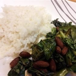 Nutty American Stir Fry Recipe - Start New Year's day off with a plate of collard greens cooked in sesame oil and served alongside fluffy white rice.