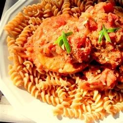 Salmon Sarciado Recipe - This easy recipe makes salmon in a tomato-based sauce with onion and garlic.