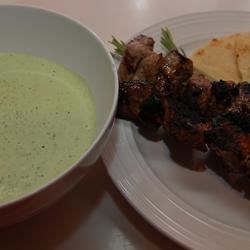 Greek Lamb Kabobs with Yogurt-Mint Salsa Verde Recipe - Pieces of lamb tenderloin are marinated in garlic, oil, and sherry vinegar, then threaded on rosemary skewers and grilled. A creamy salsa verde of Greek yogurt, fresh mint, oregano, and parsley complement these skewers nicely!