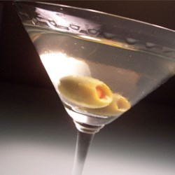 Dirty Martini Recipe and Video - A vodka martini is sullied with olives and brine from the olive jar. It can be served on the rocks, or strained into a chilled cocktail glass.