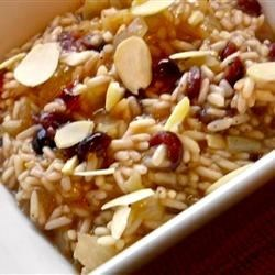 Cranberry and Almond Rice Pilaf  Recipe - Sweet and tart dried cranberries are the highlight to this simple rice dish. Slivered almonds add a delicious and hearty crunch.