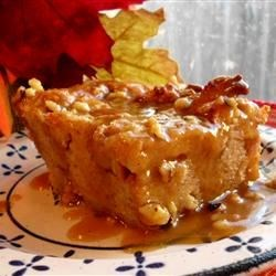 Bread Pudding with Praline Sauce Recipe - A buttery and sweet sauce with pecans tops this bread pudding you'll be happy to present at your next holiday dinner table.