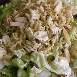 Napa Cabbage Noodle Salad Recipe - Napa cabbage has a delicate peppery taste and is wonderful in this salad. And there 's lots of crunch, almonds, sesame seeds, and crumbled Ramen noodles are tossed into the finely shredded cabbage and dressed with a balsamic vinegar/soy sauce dressing. Makes six generous servings.