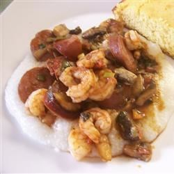Shrimp and Grits for the Displaced Southerner Recipe - Shrimp and Grits - it's not just for breakfast anymore. This exciting version makes a spicy combination of shrimp, sausage, and mushrooms, served over savory, creamy grits.