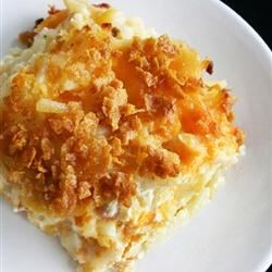 Cheesy Hash Browns  Recipe - Hash brown potatoes are baked in a creamy, cheesy sauce for a brunch main dish or a nice side for dinner.