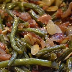 Green Beans with Almonds Recipe - This is one of those dishes that tradition has snatched. Most everyone has a green bean dish on the menu for the holidays. The almonds are a nice detour from the usual ingredients.